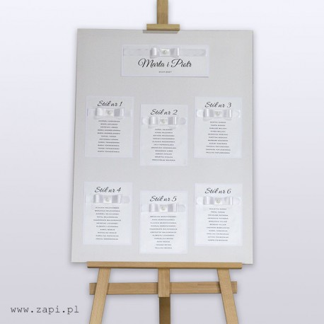elegancka biała tablica dla gości weselnych